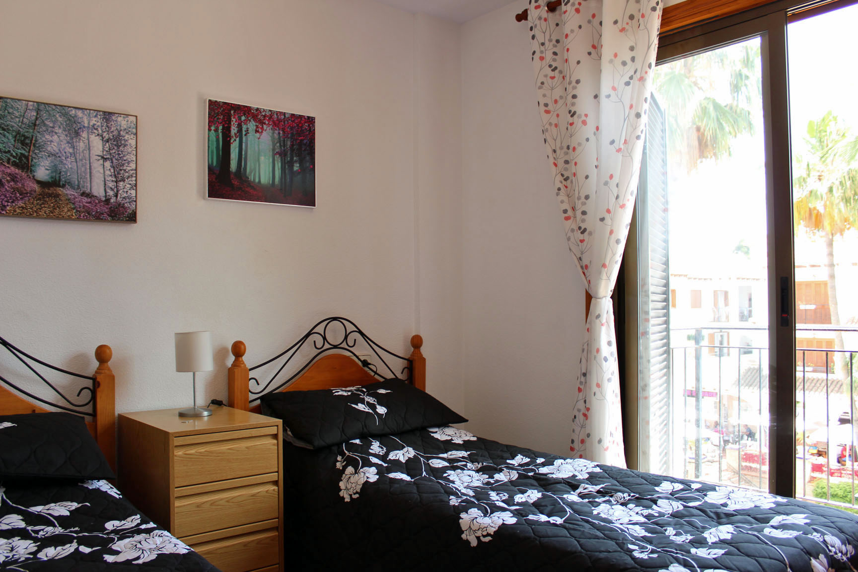 ITSH Property Bedroom with 2 singles and private balcony views 8