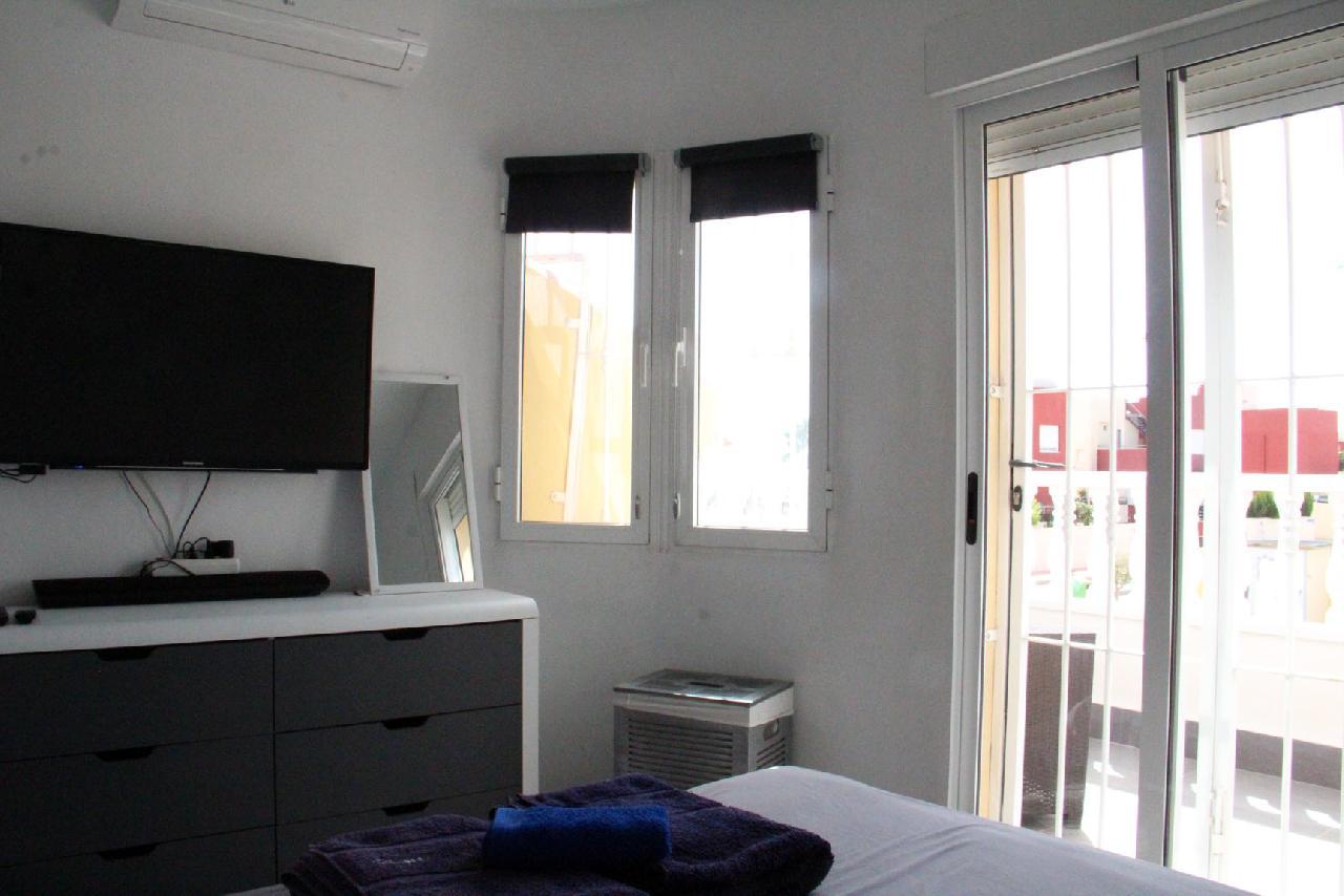 itsh 1631312124YNWEKC ref 1768 mobile 12 Master bedroom, private balcony and TV Villamartin