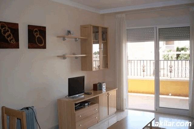 itsh 1553589344PVIFKX ref 1109 mobile 3 Large living room with UK TV Villamartin