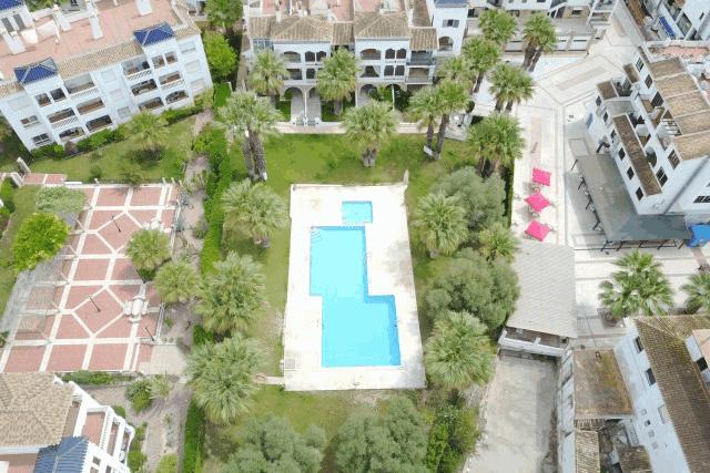 itsh 1522133366LVTRJM ref 1724 mobile 3 communal pool by Drone Villamartin Plaza