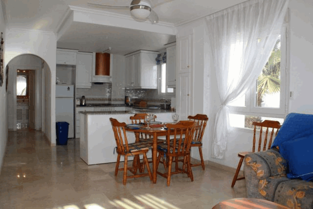 itsh 1578332977JCAXUS ref 1753 mobile 4 The dining area for 4 and Kitchen Villamartin