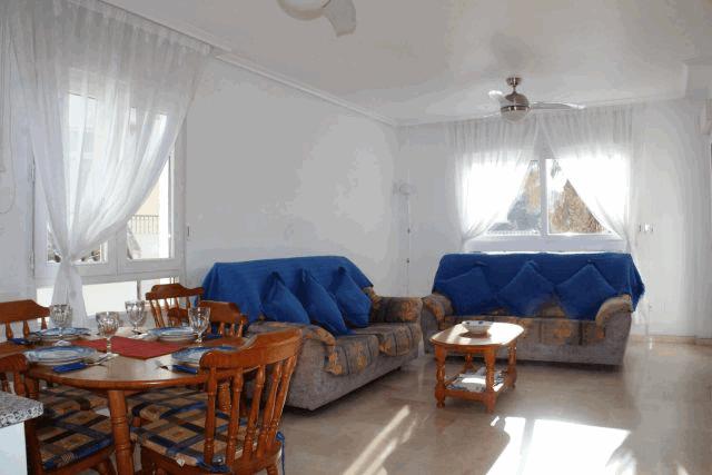 itsh 1578332977JCAXUS ref 1753 mobile 3 Living room and dining area of the apartment in Villamartin Villamartin